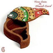 Shank Design Kumkum Chopra made in wood and clay.